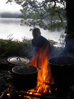 bush craft boiling water over an open fire lake district