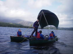 Open canadian canoe sailing Coniston