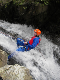 Aquaseiling abseiling down waterfalls Coniston, Langdales valley