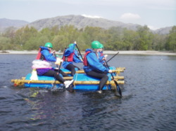 Raft building hen party Coniston Windermere Lake District Cumbri